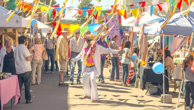 The First Annual LGBTQ Pride Festival was held Saturday in downtown Silver City. Market Street was decorated with colorful flags to recognize the first celebration.