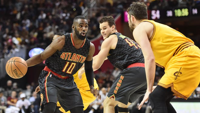 Atlanta Hawks guard Tim Hardaway Jr. drives to the basket against Cleveland Cavaliers forward Kevin Love during the second half at Quicken Loans Arena. The Hawks won 114-100.