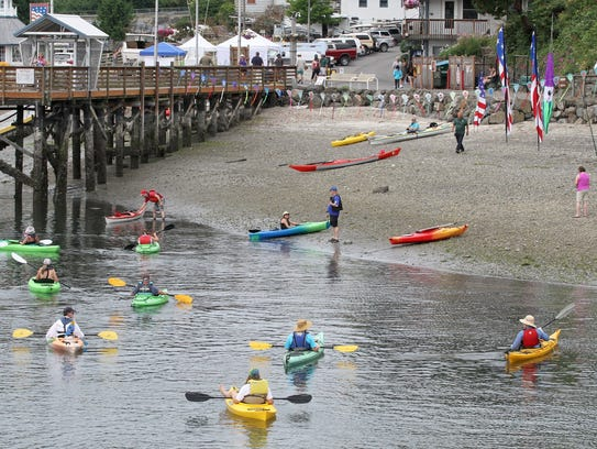 Kayakers return to shore at the Brownsville Marina before embarking on the longer paddle to Keyport at the Kitsap Water Trails Festival.