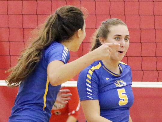 Howards Grove's Olivia Stauss (5) reacts to a point scored against Sheboygan South on Saturday Sept. 10, 2016, at South.