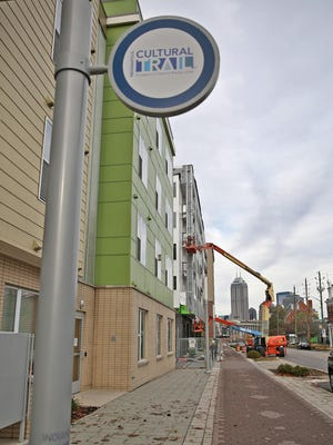 The Cultural Trail runs on Virginia Ave. past Mozzo Apartments, at 531 Virginia Ave., Friday, November 6, 2015. The development along Virginia Ave. in the city's Fletcher Place and Holy Rosary neighborhoods has gone from almost nothing along the stretch five or six years ago to now being one of the city's hottest neighborhoods, with a mix of retailers and apartment buildings.