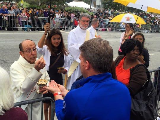 Communion along Ben Franklin Parkway in Philadelphia on Sunday, Sept. 27.