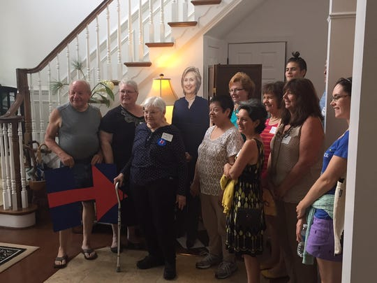 Democratic supporters at a Hillary Clinton campaign event last summer at the home of Lise Haupt in Rehoboth Beach pose with a cardboard cutout of the candidate. Clinton's campaign is the most fully formed of any effort in Delaware.