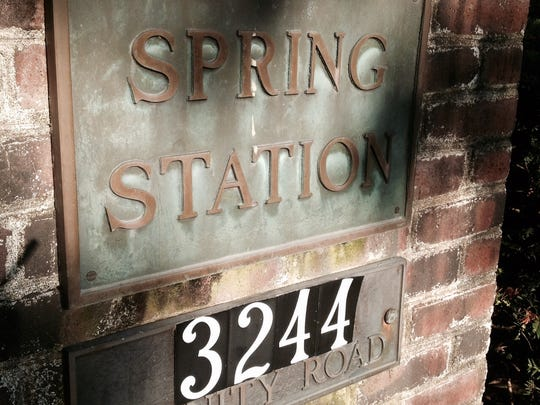 A Spring Station plaque identifies the home at an entrance on Trinity Road off Cannons Lane.