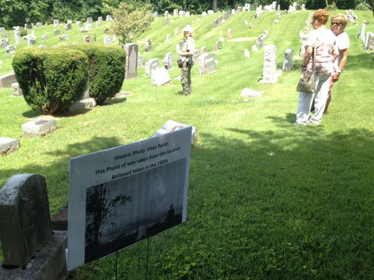A sign alerts visitors to St. Andrew Cemetery to a