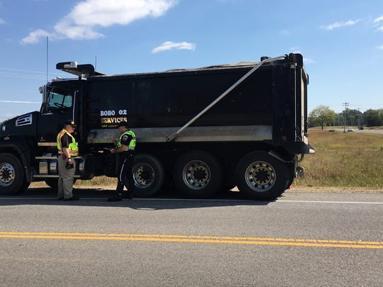 Investigators with the Fatal Accident Crash Team investigate the truck involved in the wreck. The FACT team investigates accidents involving serious injuries, not just fatalities.