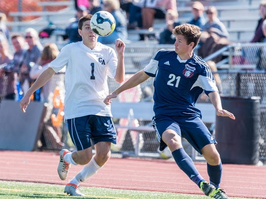 Jared Rohrbaugh (1) of Greencastle-Antrim gets a close-up look at the ball as Ryley Reed of Chambersburg closes in. The Trojans took a 4-2 win Saturday, although Rohrbaugh scored a goal.