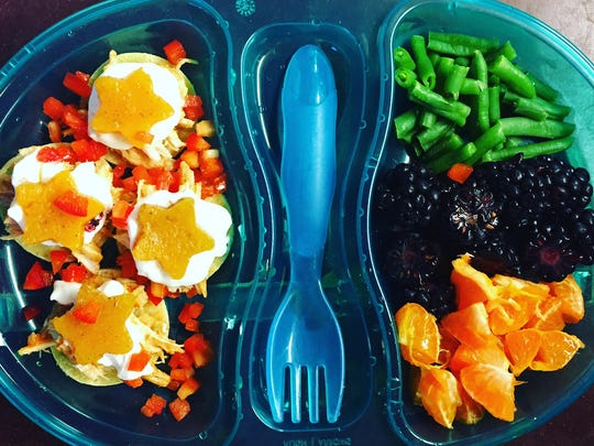 A toddler lunch, packed and ready for school, with tiny chicken tacos with Greek Yogurt and butternut squash stars.