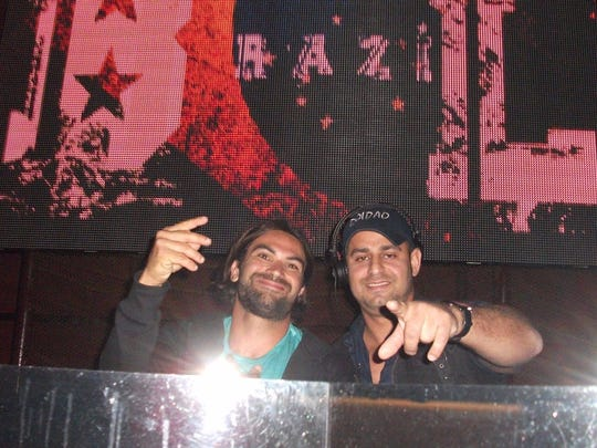 Rogerio Anjos, right, and a friend at one of his DJ jobs in Fort Myers.