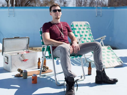 """Morgan Wallen sits in a shot from his """"The Way I Talk"""""""