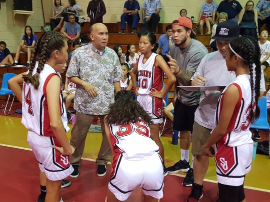 St. John's coach John Pangilinan Jr. and Daren Hechanova give game strategy to their team during the championship game.
