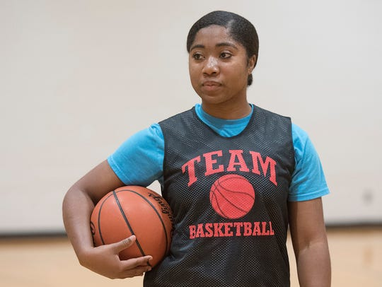 Senior Olivia Perkins is one of two former Harrison players who are now members of Farmington's girls basketball squad.