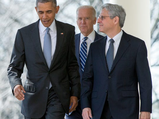 Federal appeals court judge Merrick Garland arrives with President Barack Obama and Vice President Joe Biden as he is introduced as Obama's nominee for the Supreme Court during an announcement in the Rose Garden of the White House, in Washington, Wednesday, March 16, 2016. (AP Photo/Andrew Harnik)