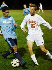 Northville's Brendan Kemp (right) tries to get a leg