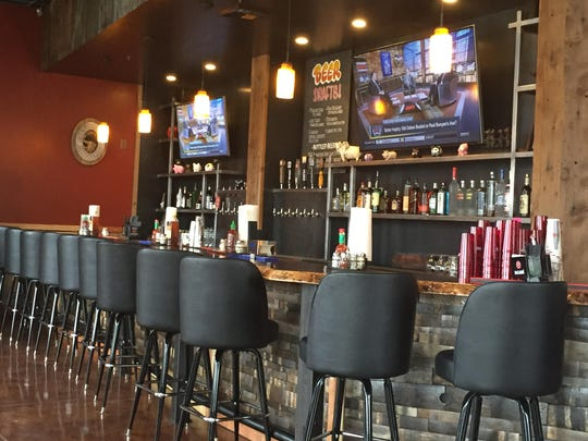 The bar stretches much of the room at the new Wild Garlic Pizza & Pub in downtown Reno. The fourth Wild Garlic location occupies the space previously occupied by Fuego.