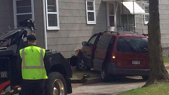 A minivan that crashed into the side of a home at 722 Cherry St. in Green Bay on Sunday afternoon, May 1, 2016, had to be towed away. The driver of the vehicle, a 45-year-old woman who lives at the residence, was arrested for suspicion of operating while intoxicated.