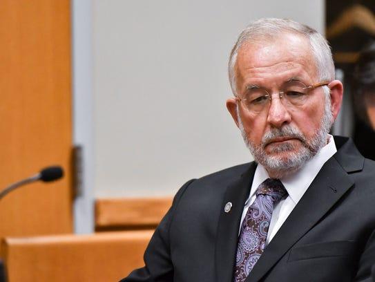 William Strampel listens as Eric Restuccia, chief legal