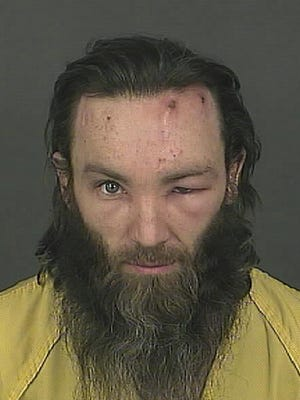 This booking photo released on Feb. 2 by the Denver Police Department shows homicide suspect Joshua A. Cummings in Denver. Cummings was arrested shortly after the point-blank shooting death of a transit guard in downtown Denver on Jan. 31.