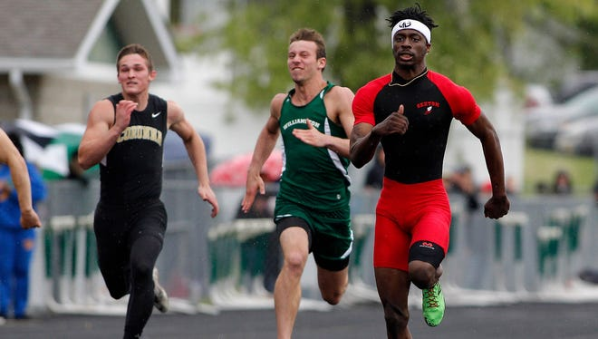 Sexton's Dariyon Gregory, right, wins the 100-meter dash ahead of Williamston's Sy Barnett, center, and Corunna's Owen Walter during the MHSAA Division 2 track regionals Friday, May 19, 2017, in Williamston, Mich.