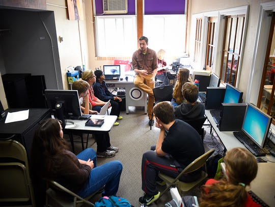 Michael Wiechmann talks with his students during a