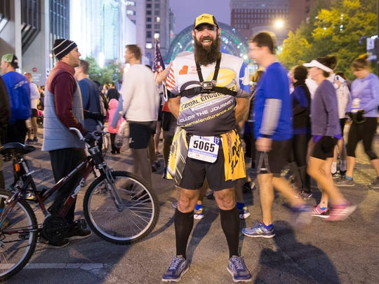 Dave Jones, who is on a quest to run marathons in all 50 states this year, near the start of the 10th running of Monumental Marathon, Indianapolis, Saturday, Nov. 4, 2017.