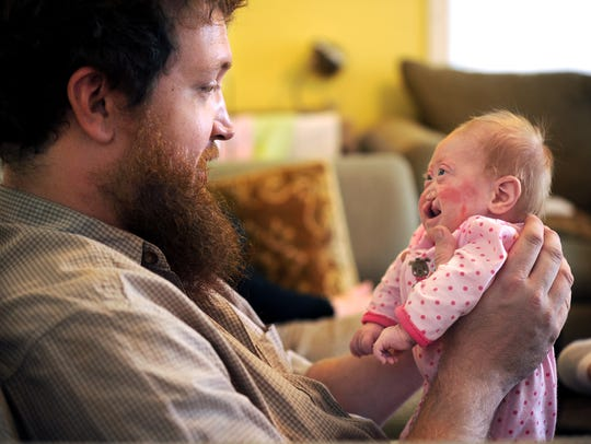 Eric Brown holds daughter Pearl Joy in October 2012.
