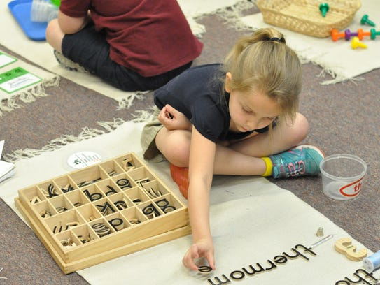 Pre-K and Kindergarten students complete hands-on tasks