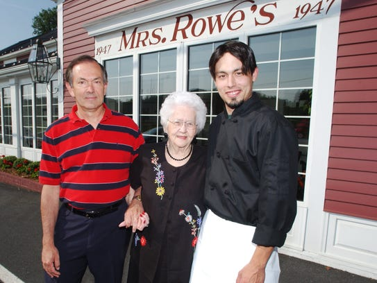 In a 2002 file photo, Mildred Rowe is flanked by her