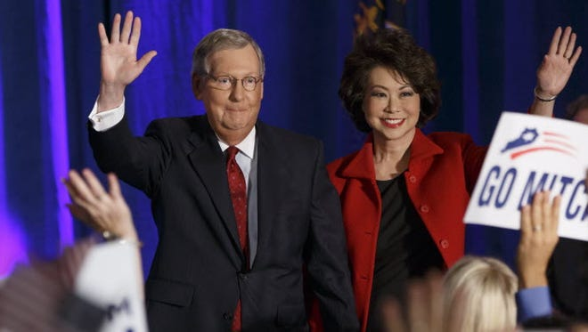 Senate Minority Leader Mitch McConnell of Ky., joined by his wife, former Labor Secretary Elaine Chao, celebrates with his supporters at an election night party in Louisville, Ky. on Tuesday, Nov. 4, 2014.