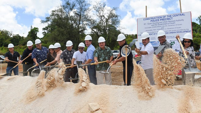Gov. Eddie Calvo, center, government officials and others participate in a groundbreaking ceremony for the Guam Police Department Central Precinct in Sinajana on Wednesday, June 14, 2017.