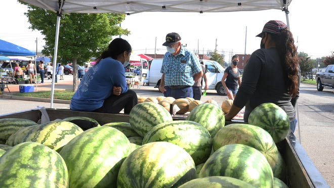 Charles Fox looks over the melons for sale, Saturday, Aug. 29, fresh from the Webber Falls fields to the downtown Fort Smith Farmers Market. The market is open Tuesday and Saturday, 7 a.m. to noon.