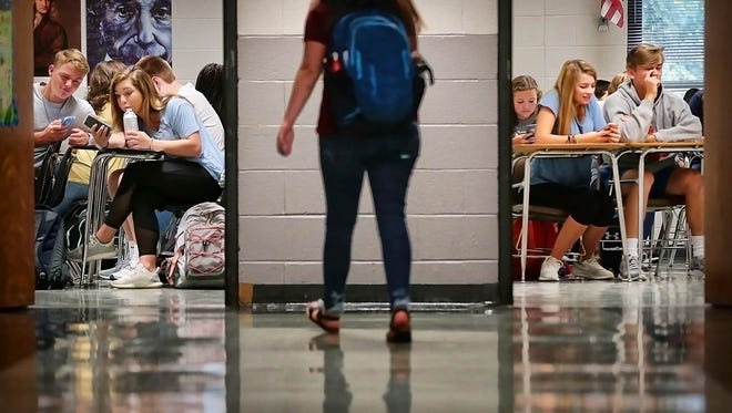Houston High School students settle in at their first period class before the bell rings at 7:45 a.m. In a county where nearly every high school starts at 7 a.m., Germantown Municipal School District pushed back start times last year.