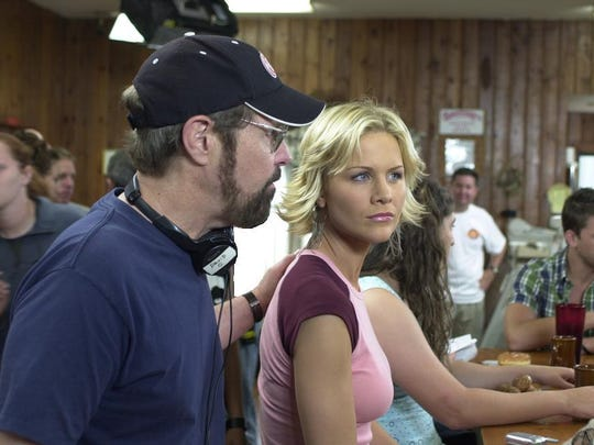 """David O'Malley talks with actress Josie Davis during a break in the filming of the movie """"Kalamazoo?"""""""