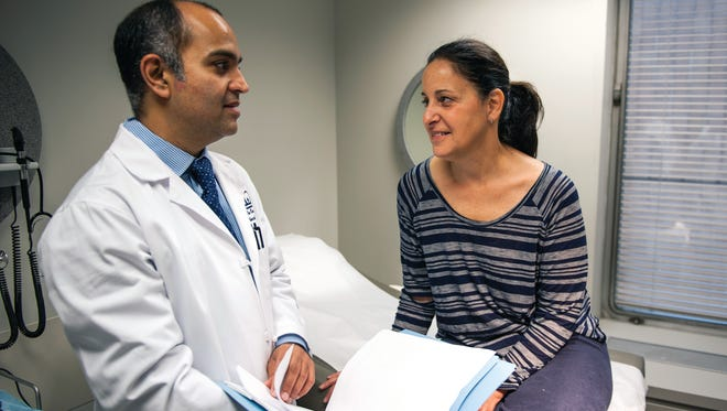 Chief of the Division of Colorectal Surgery at NewYork-Presbyterian Hospital/Columbia University Medical Center Dr. P. Ravi Kiran works with a patient.