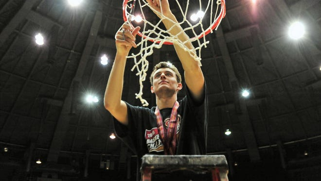 Belmont's Taylor Barnette  cuts down a piece of the net after defeating Murray State in the OVC title game.