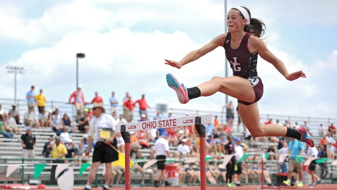 Karlie Zumbro of the John Glenn Muskies competed in the girls 300-meter hurdle race at the state track meet at Jesse Owens Memorial Field on Saturday in Columbus.