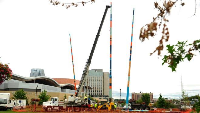 Workers help install Stix at the Korean War Veterans roundabout near Music City Center on Sept. 28, 2015.