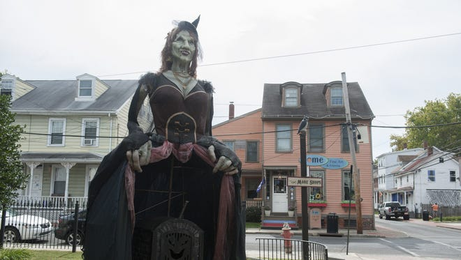 Mona, a 20-foot witch, serves as the centerpiece for the 2014 Witches Ball in Mount Holly.