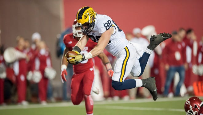 Michigan tight end Jake Butt scores a touchdown during the first overtime Saturday.