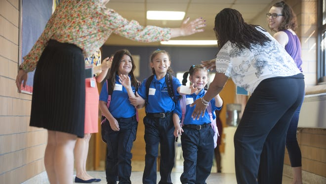 Teachers greet students on the first day at Mastery Charter School in North Camden last year.