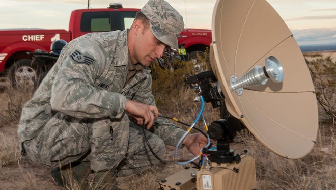 Staff Sgt. Michael Lindsay, a Hammer Adaptive Communication Element operator, disassembles a Panther terminal outside an F-16 crash site northwest of Salinas Peak, New Mexico on Nov. 26. Hammer A.C.E. operatives provide strategic communications for emergencies, both military and humanitarian, worldwide at any time.