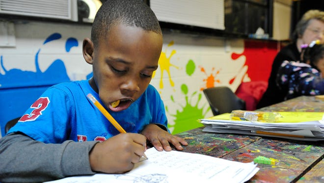 Kindergartner Zyran, 6, works on study sheets at Youth Encouragement Services in Nashville.