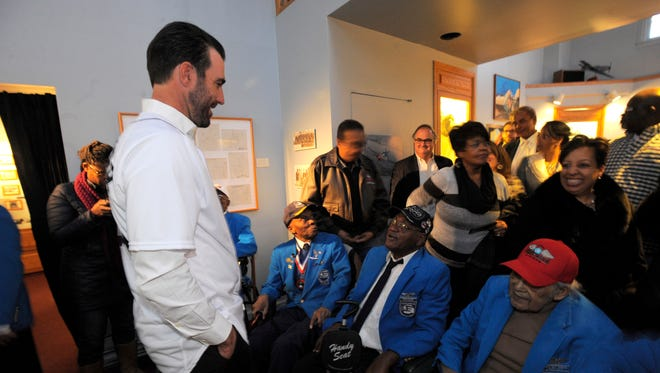 Justin Verlander speaks with Tuskegee Airmen Washington Ross, Jesse Rutledge and William Thompson on Thursday at the Tuskegee Airmen Museum in Detroit.