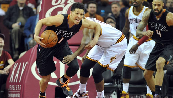 Jan 27, 2016: Phoenix Suns guard Devin Booker (1) grabs a loose ball from Cleveland Cavaliers center Tristan Thompson (13) during the first quarter at Quicken Loans Arena.