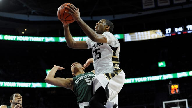 Martez Walker's first two games for Oakland: 18 points Dec. 19 at Washington and seven points Dec. 22 vs. No. 1 Michigan State (above).