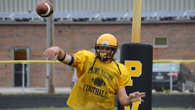 Paint Valley quarterback Bryce Newland warms up before a scrimmage against Fayetteville last season, as a freshman, at Paint Valley High School.