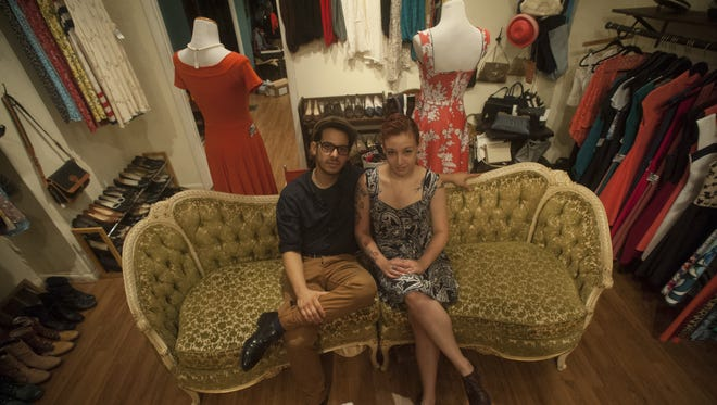 Arielle Salkowitz  and  Rafael Rosado sit on a vintage sofa in her store, Nostalgia Vintage & Contemporary in Queens Village, Philadelphia.  Salkowitz sells both vintage and her own fashions in the boutique.