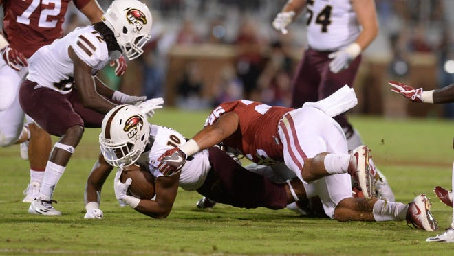 ULM's D'Marius Gillespie (10) dives for extra yardage against the Oklahoma defense on Saturday.