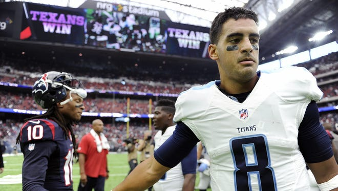 Titans quarterback Marcus Mariota (8) shakes hands with Texans wide receiver DeAndre Hopkins (10) as he walks off the field after the team's loss Sunday.