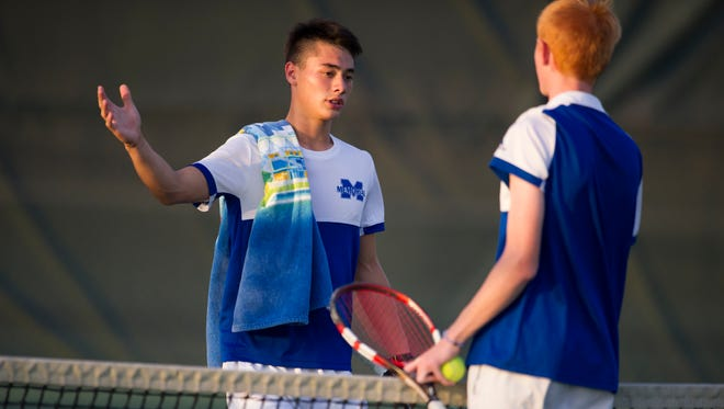 Memorial's Brandon Wu, left, and Castle's Evan Bottorff congratulate each other after their match during the Bosse boys tennis regional at North High School in Evansville, Wednesday, Oct. 5, 2016. Wu won 6-1, 6-2.